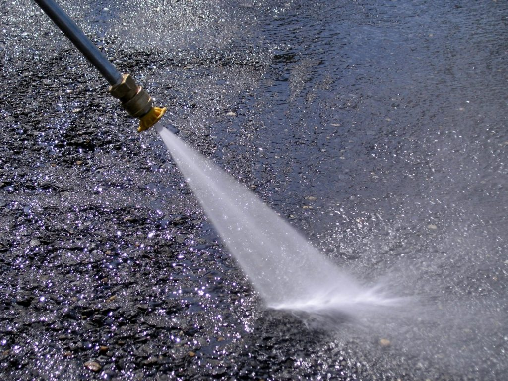 A high-powered pressure washer can be used to clean road, metal roof, and garage floor
