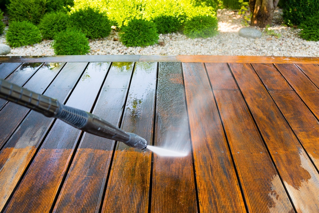 A medium-duty pressure washer with about 1,7000 PSI is good for cleaning wooden deck