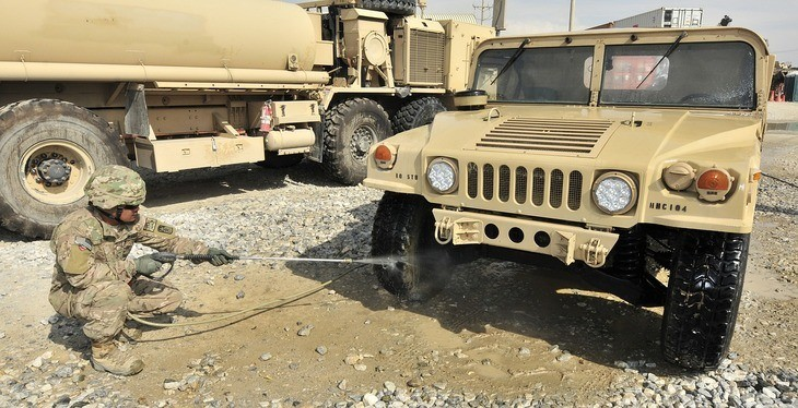 A pressure washer used in cleaning  the wheels of military truck
