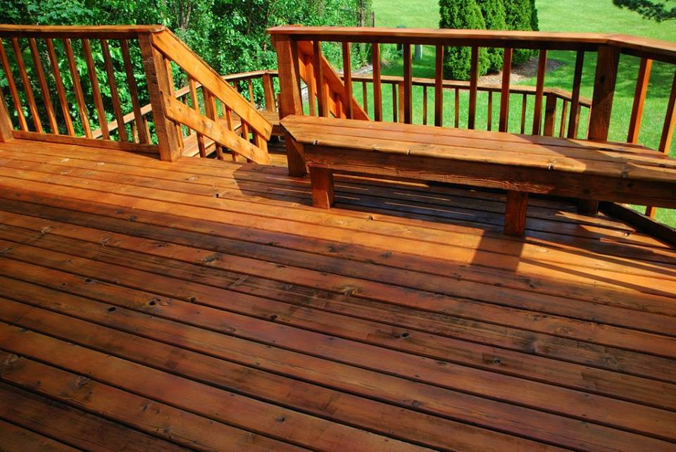 A common deck transformed like new after having been cleaned up and re-stained